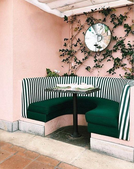 Want to try out this trendy hue but aren't sure if it works with your existing furniture? Try taking it outside, and paint a nook or an accent wall in the cheerful color. Bonus points for adding bold cabana stripes in a contrasting hue like forest green!