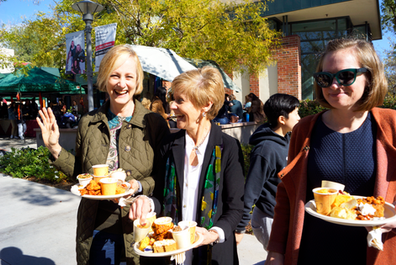 Kathleen O'Reilly, Senior College Counseling Associate, Lynn O'Grady, Director of College Counseling, and Marcie Robinson,College Counseling Associate with theirplates filled with yam-flavored foods