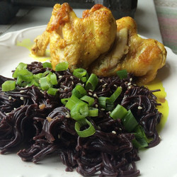 Black rice noodles with green onion and turmeric coconut chicken