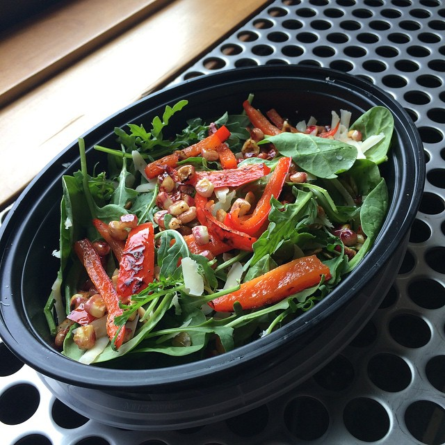 Arugula, spinach, roasted red pepper and corn, pepitas and Parmesan in a citrus cumin dressing
