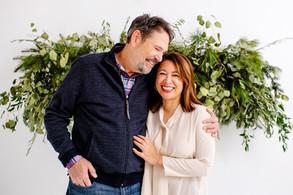 couple photoshoot in cincinnati in front of christmas greenery