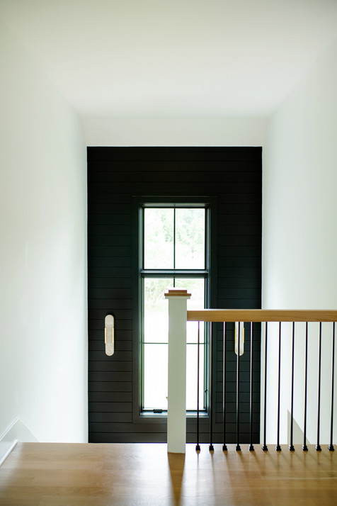 black stairwell accent wall