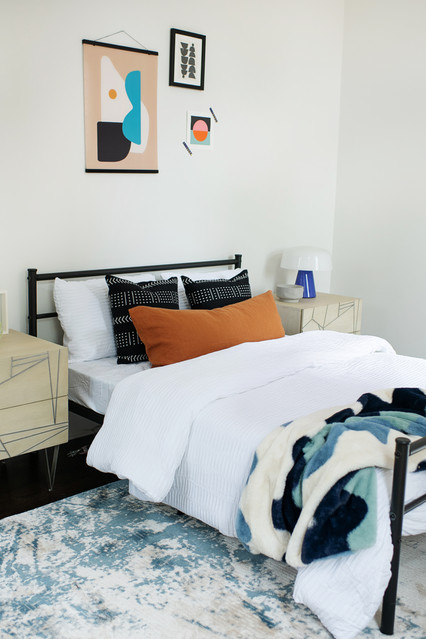 modern metal frame bed with colorful art