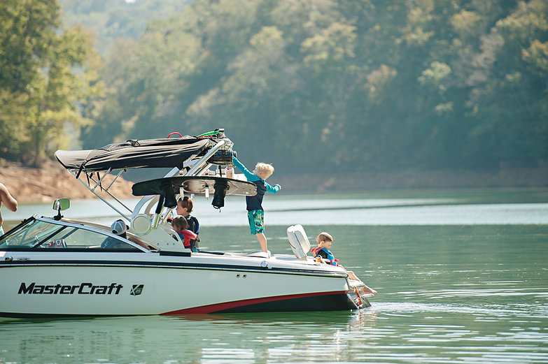 mastercraft photography at lake norris tennessee kids on the boat jumping in lake