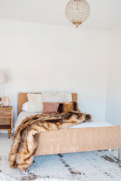 boho bedroom with fabulous furs faux throw blanket