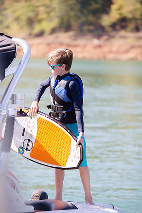 mastercraft photography at lake norris tennessee kids on the boat wake boarding