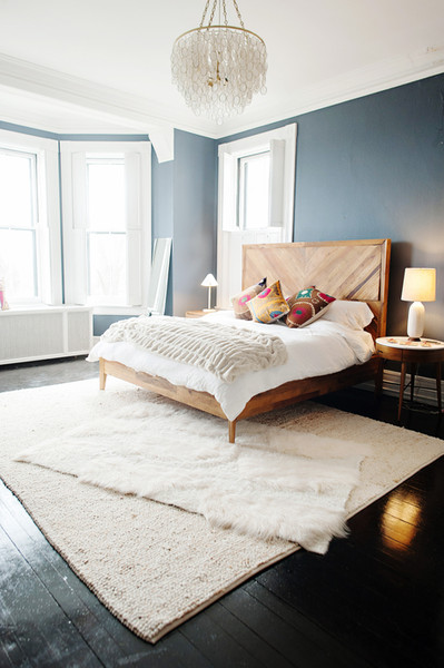 blue bedroom with custom wood feature headboard and fabulous furs faux throw blanket