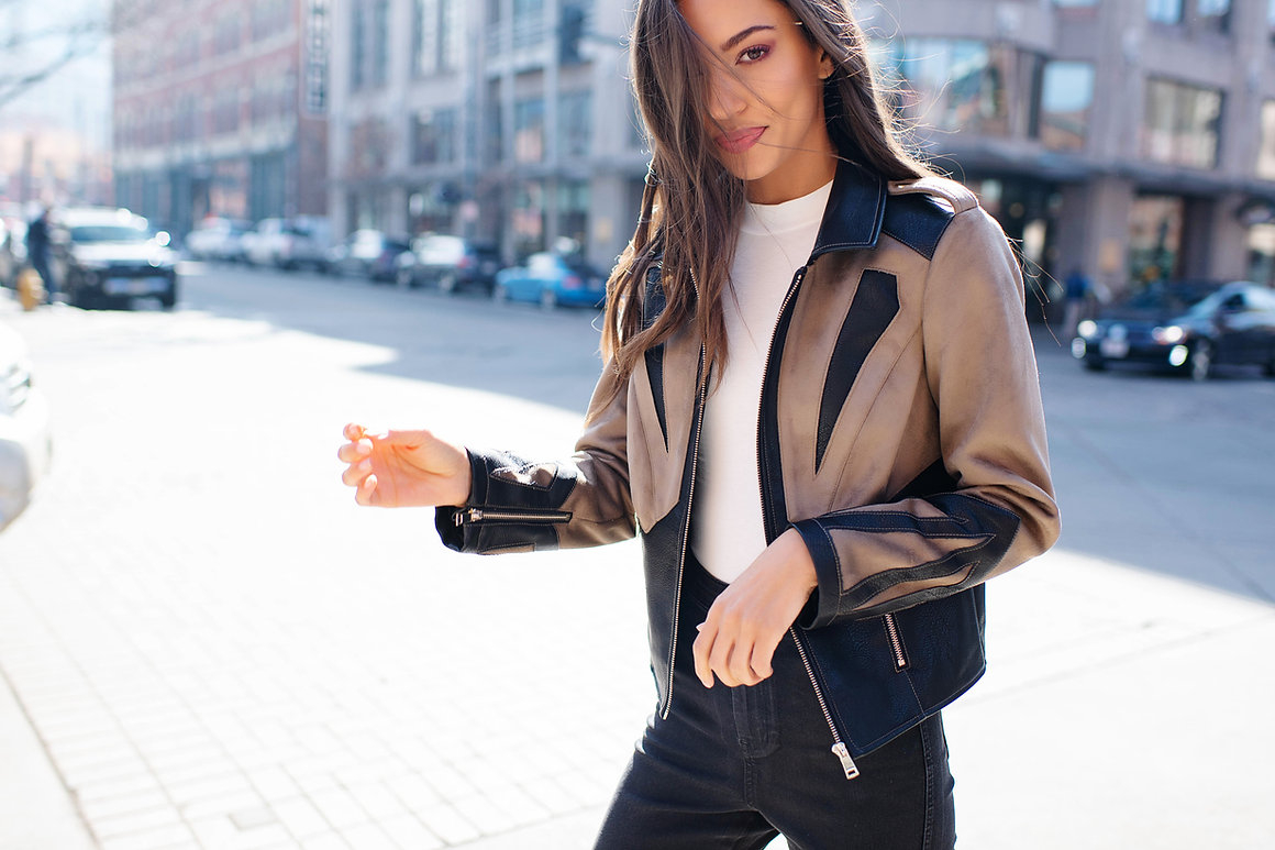fabulous faux fur fashion brand photography in city of chicago in brown leather jacket
