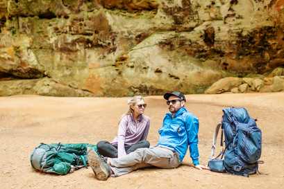 couple at hocking hills cave backpacking photoshoot commercial photography luxottica