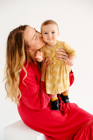 mother daughter christmas picture on simple backdrop in cincinnati