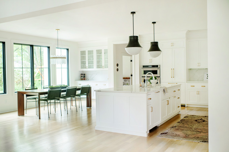 modern white kitchen with black pendant lights