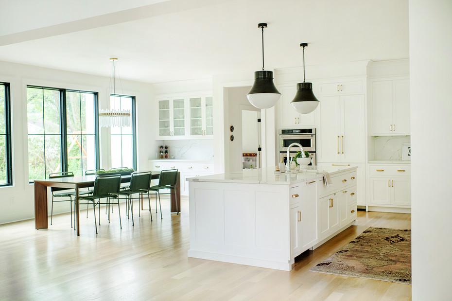 modern white kitchen with black pendant lights