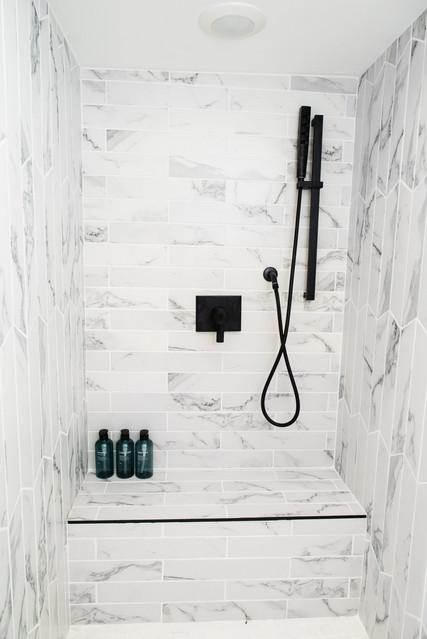 full white tile shower marble black fixtures