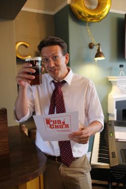 Matt says Cheers at Pub Choir_edited