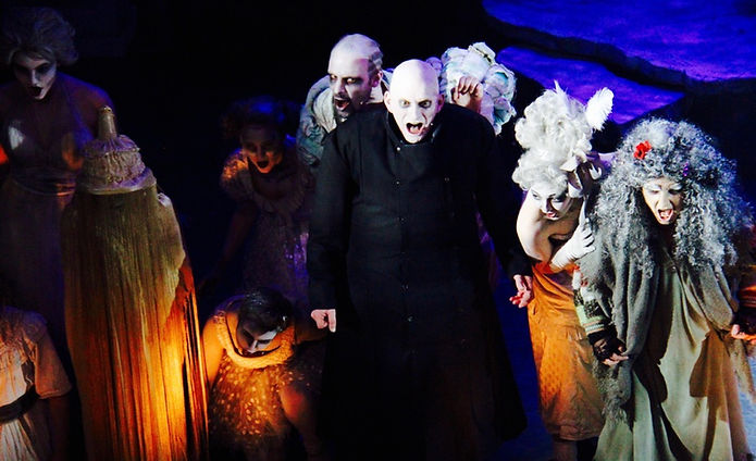 Mark Hird as Uncle Fester and Susannah Baines as Grandma with the Addams Family ancestors