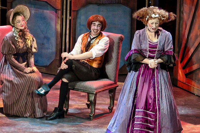 Mabel Goulden as Miss Neville, Sam Baxter as Tony Lumpkin and Juliet Waters as Mrs Hardcastle in Pick Me Up's She Stoops To Conquer