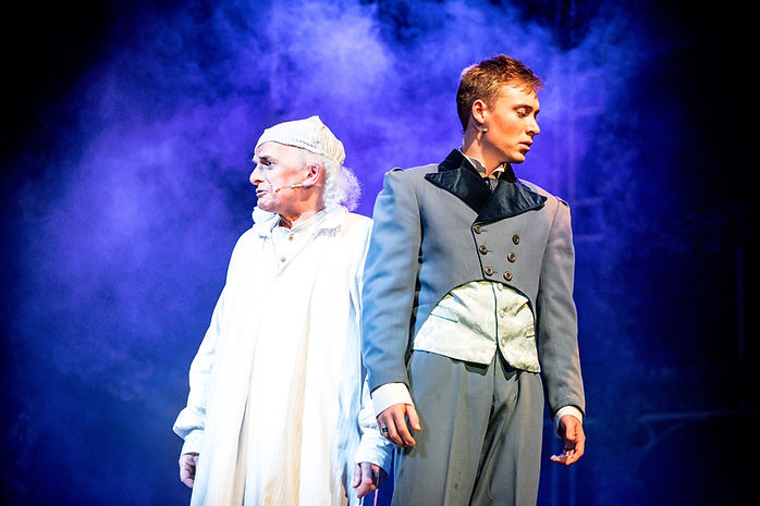 Mark Hird as Scrooge and Frankie Bounds as Young Ebenezer in Leslie Bricusses's Scrooge The Musical