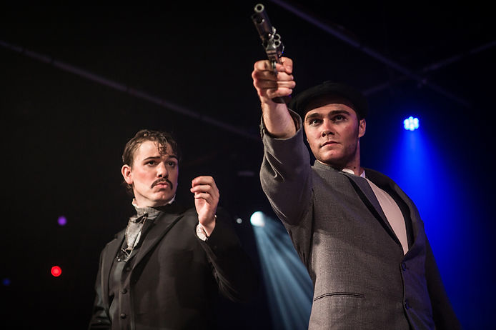 Simon Radford as John Wilkes Booth and George Stagnell as Leon Czolgosz in Sondheim's Assassins