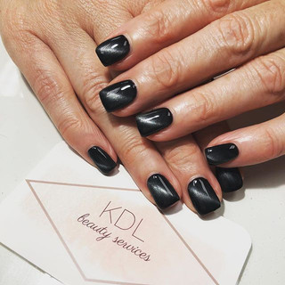 Halloween inspired cat eye nails 🎃 Polished on Black 🖤