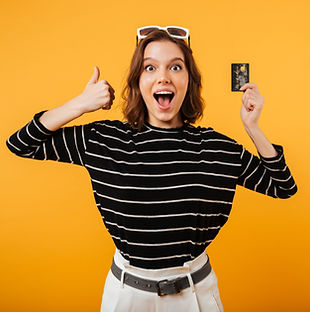 portrait-of-a-happy-girl-holding-credit-