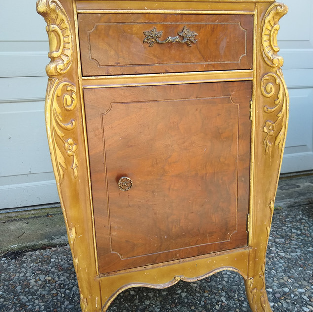 Small cabinet with decorative side scrolling