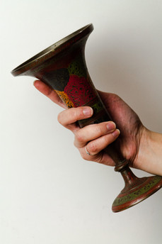 antique brass vase used as prop