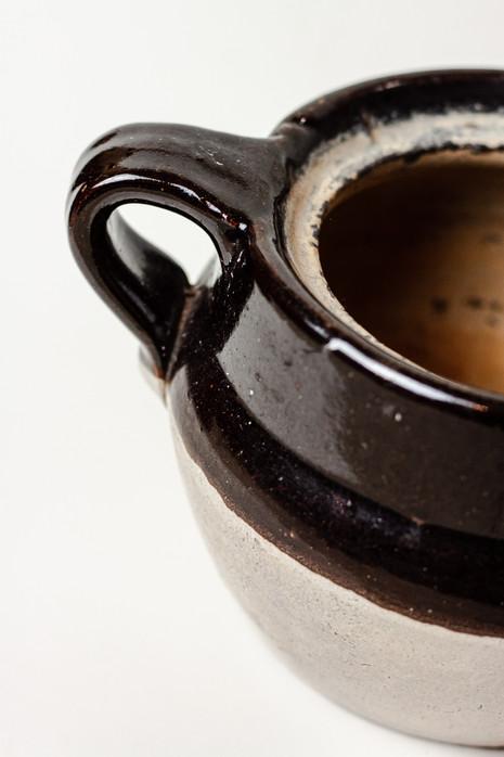 (detail) antique ceramic crock used as prop