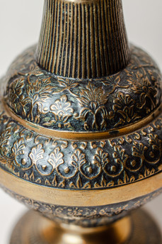 (detail) antique brass oil pitcher used as prop