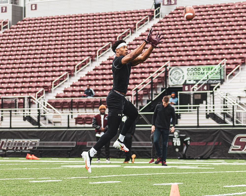Photo by Greg Camillone: Former Safety, Jeremy Chinn performs drills in front of NFL scouts at SIU Pro Day.