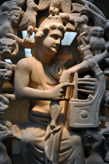 Statue of Orpheus seated, playing lyre, surrounded by animals, including ape poised atop instrument. Athens, Byzantine Museum, BXM 1 (Aegina, 4th cent).