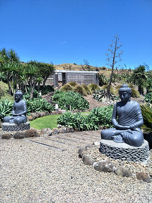Buddha statues beside a pathway outdoors