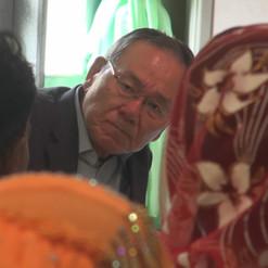 Ambassador Kenzo Oshima, member of the ICOE,  meets with locals at Nga Khu Ya Reception Centre in Nga Khu Ya Village