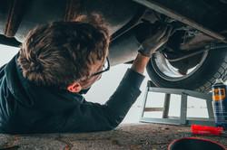 auto repair man under hood normans glass