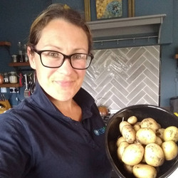 Joanne with new potatoes from the garden