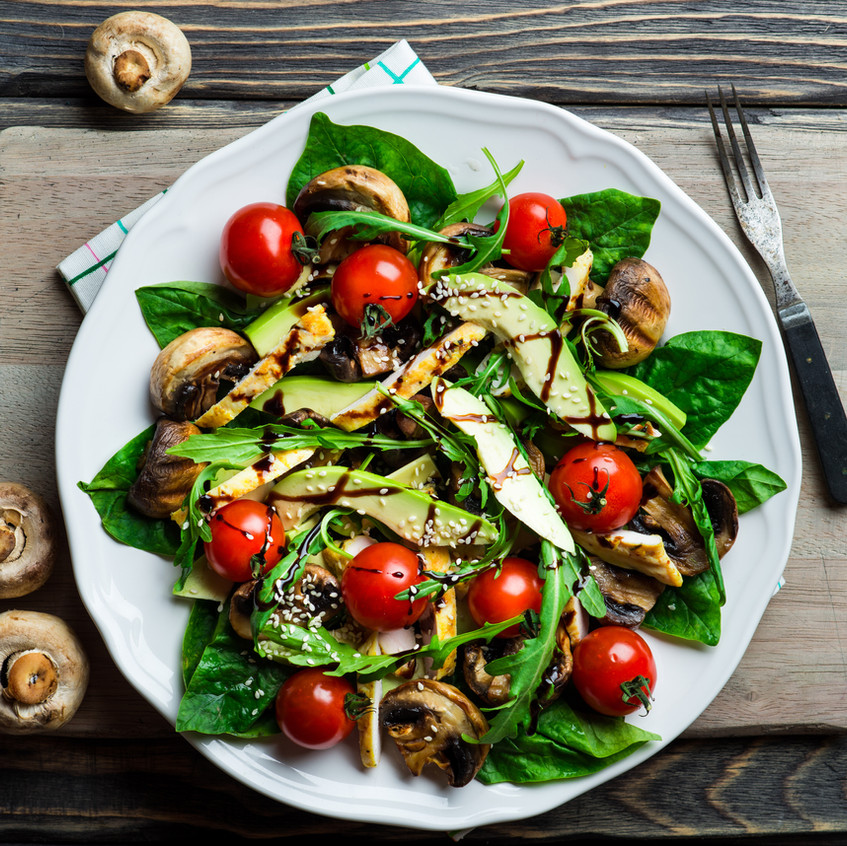 Salad with balsamic dressing and avocado