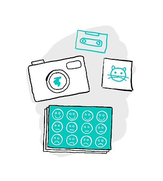 drawing of a camera, photo of a cat, cassette tape and feelings card