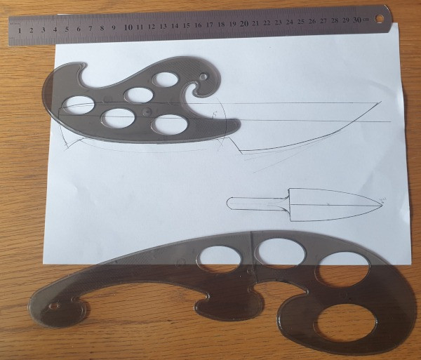 Early knife designs on paper, showing bad proportions