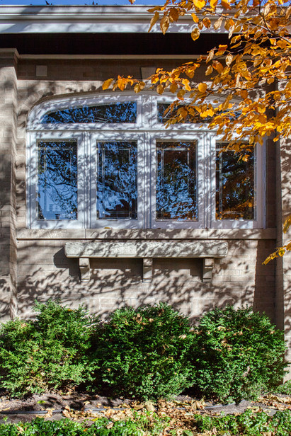 Nancy Jane and Frank's bungalow had beautiful original art glass windows, but the arched upper portions were exposed to the elements. They hired carpenter Vito Pascolla to construct custom wood storm windows that blend in, and now the room is less drafty, noise is reduced, and the historic windows are protected.