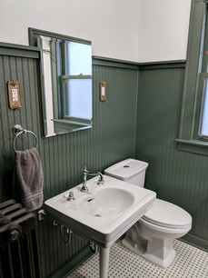 Joshua and his wife Kelly loved the original tile walls in their bungalow bathroom, but it was unfortunately too damaged to save. After researching 1920s bathrooms, Joshua added beadboard wainscoting to match the original tile floors. He also restored the original window, radiator, and tub, and added modern conveniences.