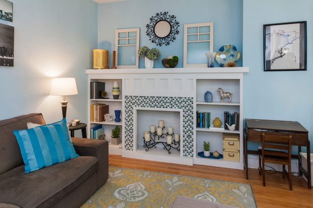 Josh and Alicia wanted to bring a cozy feeling back to their living room, where the original fireplace had been removed by previous owners. They visited neighbors' bungalows to help them select a design, and in just a weekend, constructed a faux fireplace with built-ins themselves!