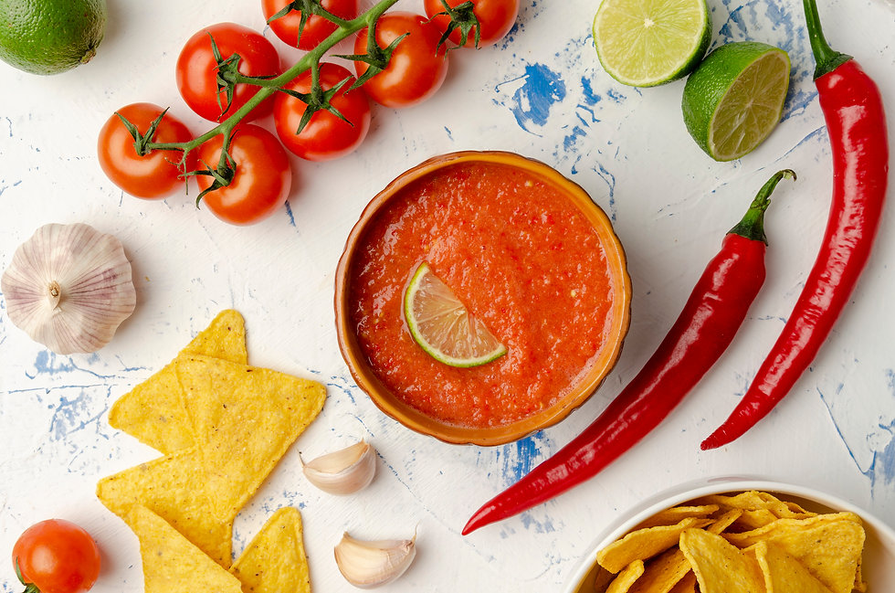 Mexican nacho chips and salsa dip in bow