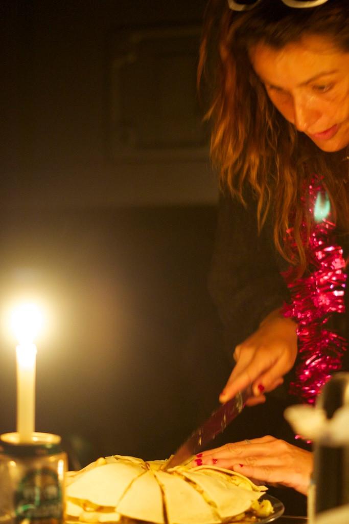 Berna cutting her birthday cake