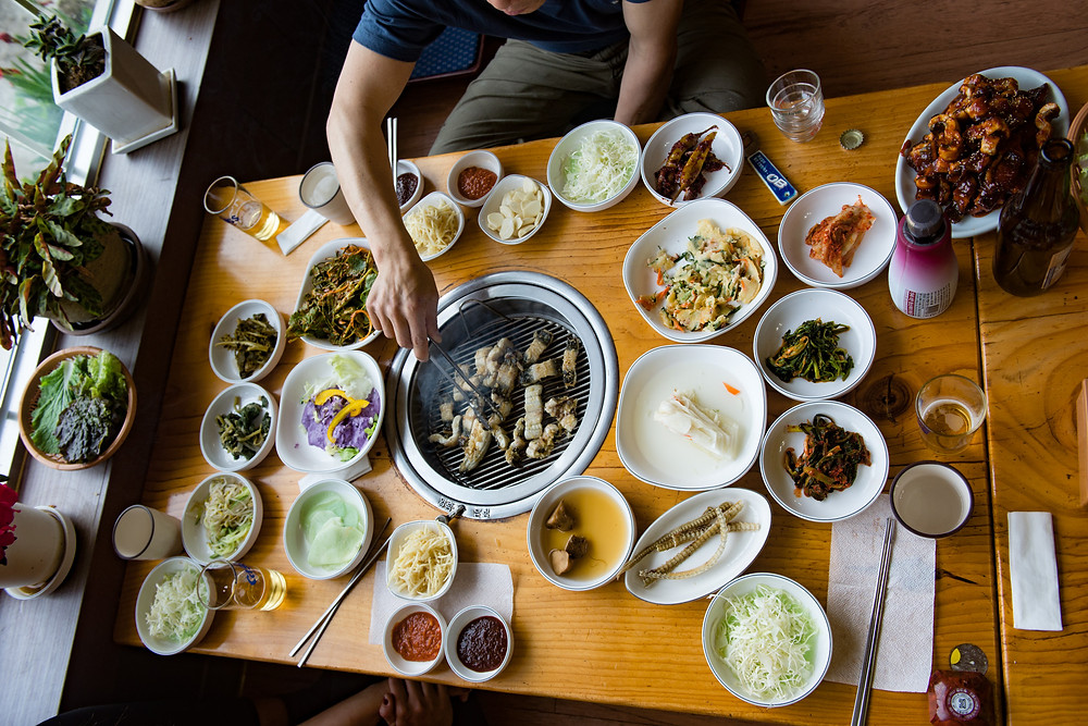 A typical Korean table setting, barbecue and lots of side dishes...