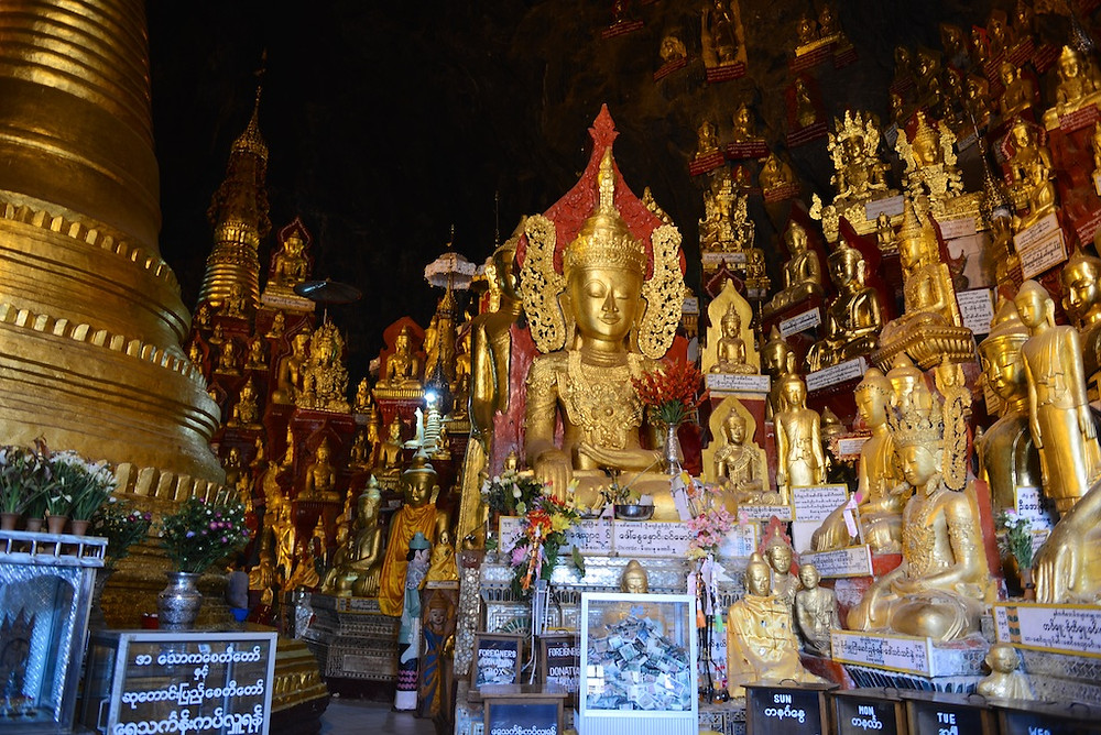 Buddha cave with donation boxes