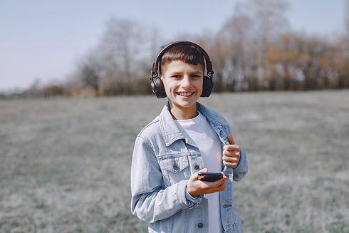 smiling-child-listening-to-music-in-head