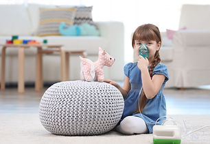 Cute little girl using asthma nebulizer