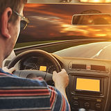 Man driving the car in the evening.jpg