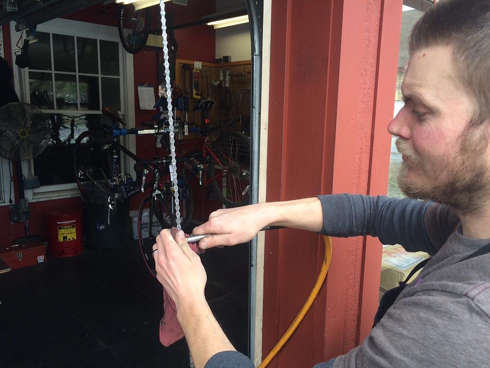 Adam cleaning a rusty chain