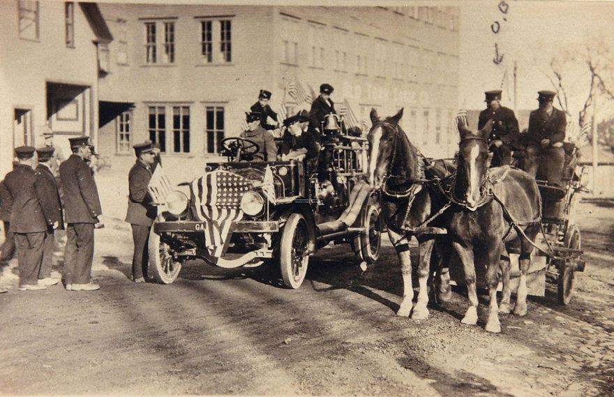 Old Town 1917 Garford along side Old Town's Fred and Ted. Photo donated by Bangor Hose 5 Fire Museum.