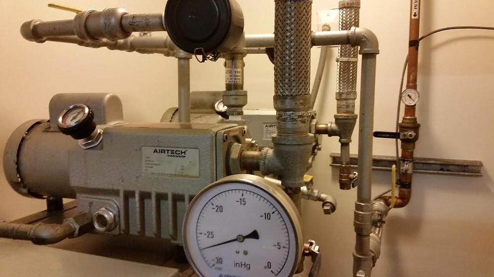 Rebuild and installation of vacuum pump system.